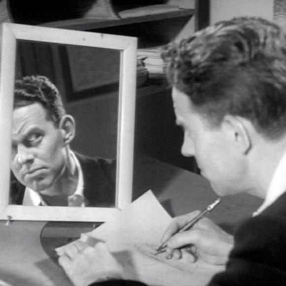 Disney animator Norm Ferguson practicing facial expressions